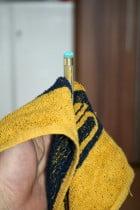 Queue mit dem Handtuch abziehen